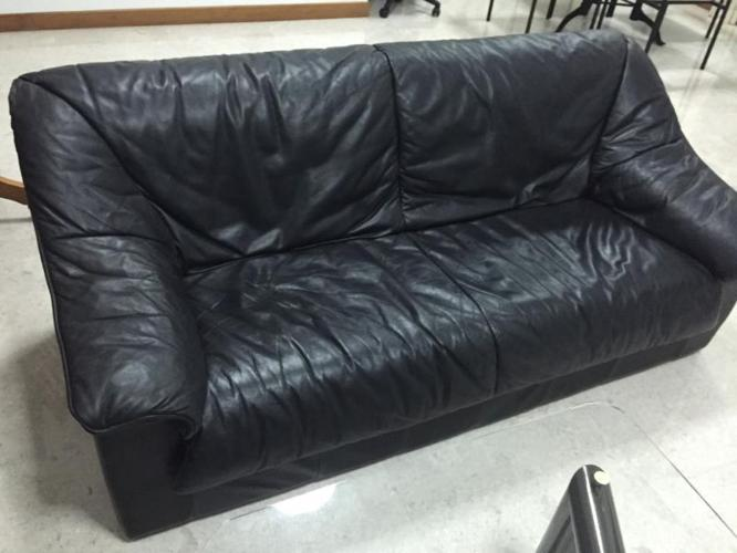 2 Black leather sofas with a FREE COFFEE TABLE!