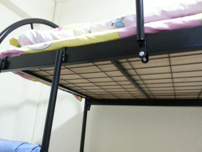 almost new double deck bed with 2 pieces of plywood at