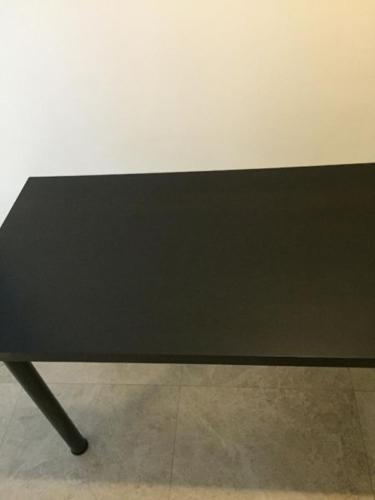 Black brown IKEA table with black metal legs