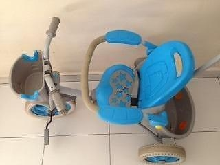 Blue baby tri cycle with pusher