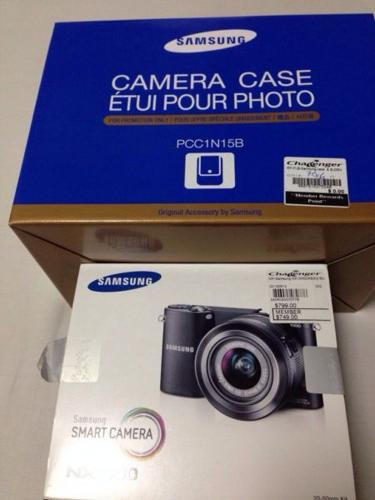 BRAND NEW SAMSUNG NX1000 with CAMERA BAG for only SGD