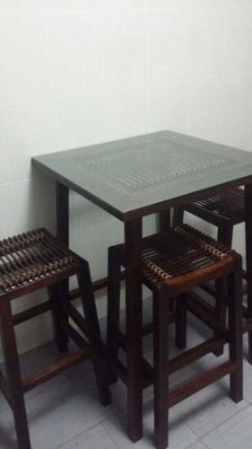 Custom Balinese solid wood & rattan tall table and