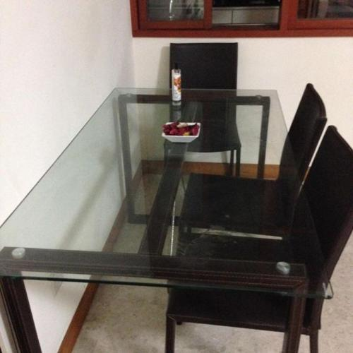 Dining Table with tempered glass table top..with four