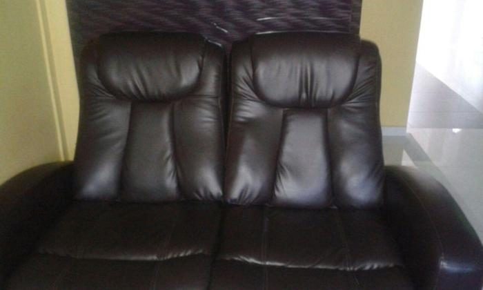 Double recliner sofa. Very well kept. Hardly used