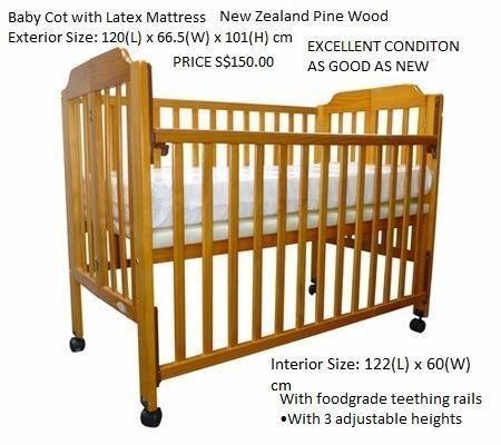 HARDLY USED BABY COT MADE FROM NEW ZELAND PINE WOOD -