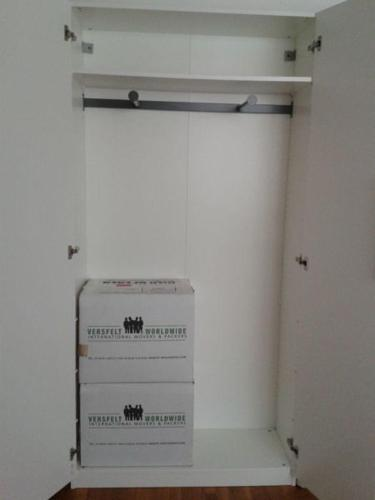 Ikea PAX frame White wardrobes (wall mounting).