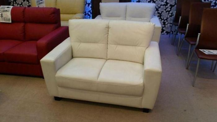 Like new beige two seater leather sofa for sale!!!