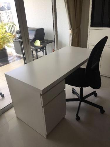 MALM desk (white) and FLINTAN swivel chair (black),
