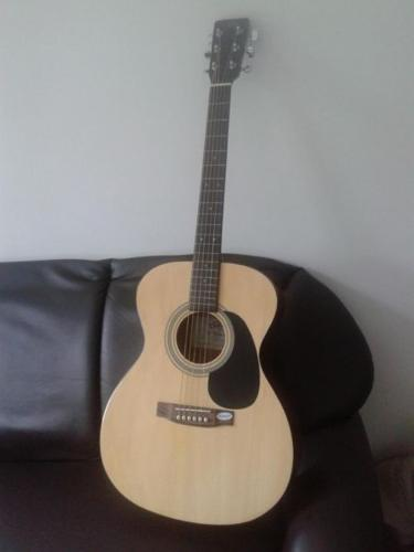 Nice acoustic guitar available for sale for just 85 SGD