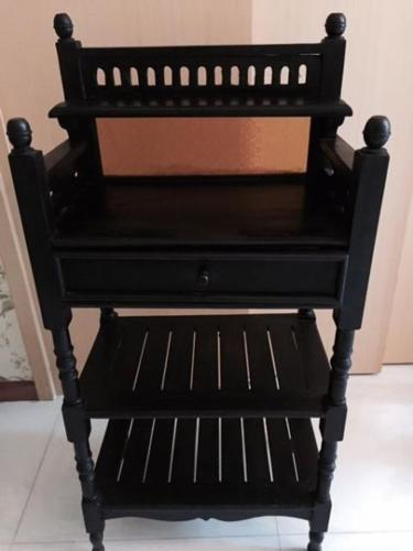 Pre-loved furniture for sale:Wooden stand in darkwood