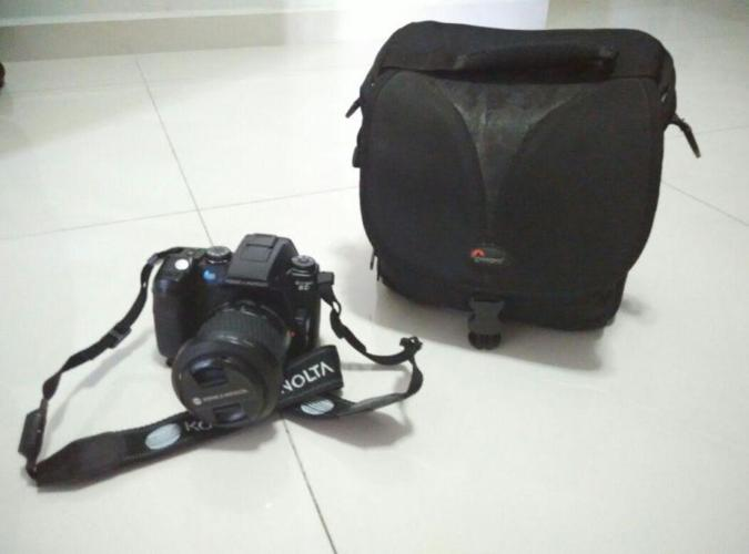 Preowned Konica Minota SLR digital camera for sale.