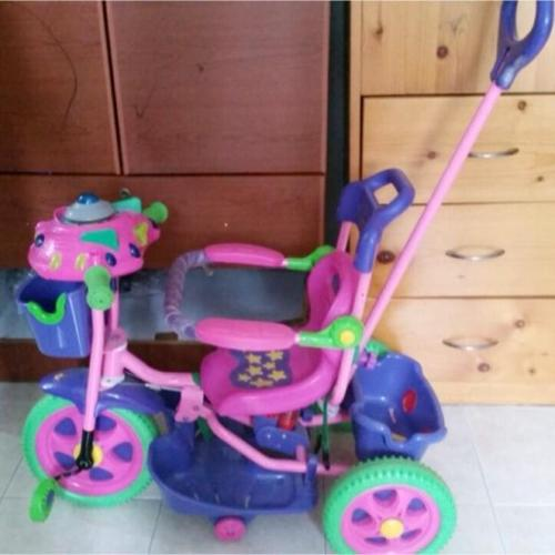 Purple tricycle