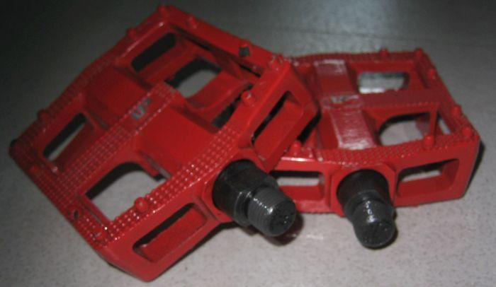 Red alloy bicycle pedals