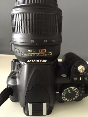 Selling Nikon camera with kit lens + 3 more lens +
