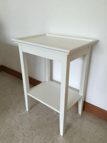 Simple, elegant, white side table.