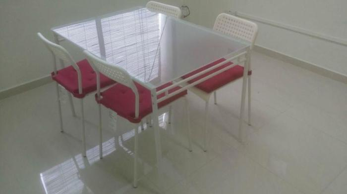 white glass table + four chairs