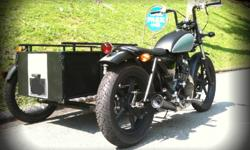Unique custom motorcycle with passenger sidecar for sale. LTA approved to carry passenger in the sidecar. COE till March 2015. What you see is what you get. SMS 91730603 for viewing