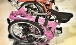 """*Picture taken next to an orange Brompton (not for sale) for comparison. Brand: MIT Cycle V8 Color: Pink Wheel size: 16"""" Speed: SRAM 8 speed Frame material: Alloy/Aluminium Weight: 12kgs Bought this for wife but she prefers a Brompton bicycle. Tested"""