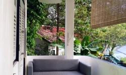 Art studio apartment, with balcony and huge garden in a nice B&W ground floor apartment, near Biopolis/one north MRT/Portdown Road. It is my workplace, unconventional, as it is an art studio. Accommodates professional couples or singles. You will have the