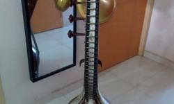 Second hand Veena with stand for immediate sale. Self collect from Clementi west street 1. Price negotiable.