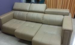 An yr old leather premium sofa for sale having
