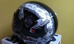 Used once only . Limited SHOEI airbrushed edition. Size