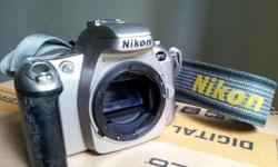 Nikon F55 in working condition. Some discolouration on