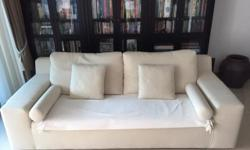 Just under two years old Cream three seat sofa