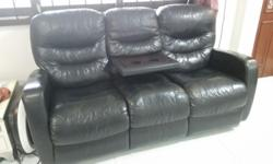Leather sofa. 3- seater recliner sofa. Attached coffee