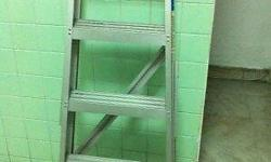 "A four steps aluminium ladder with 39"" top, good"