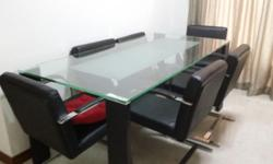 Glass top dining table with 6 chairs. While set is 18
