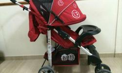 Red baby stroller with hood available immediately. The