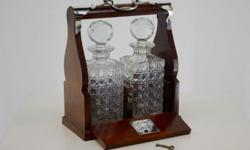 A SILVER PLATE MOUNTED TWO BOTTLE TANTALUS English,