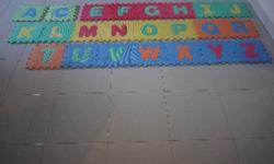 ABC Mats. Some of the letters have been stuck at the