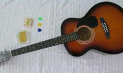 Tribal acoustic guitar with pick, tuner, extra strings
