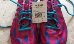 Lady adidas sports shoes for sales. Never worn before.
