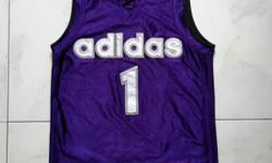 Adidas purple - blue singlet. Number one sign and with