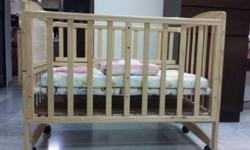 Selling almost new wooden baby cot which my baby used
