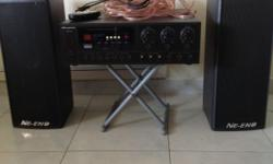 Slightly used amplifier with 2 solid speakers good for