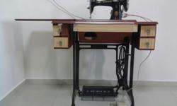 An old antique Singer sawing machines for sale at $180,