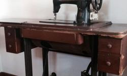 An antique sewing machine for sale.. In working