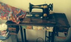 Antique Standard sewing machine and table with cast