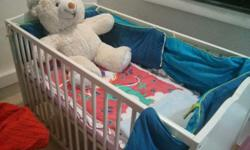 Have a baby cot with mattress, crib mobile, bedsheet,