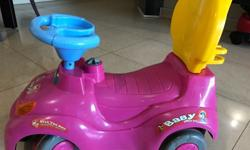 Pink ride on car for toddlers with back handle . In