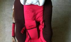 Baby rocker in pink color. The seat position can be