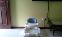 BABY WALKER IN GOOD CONDITION, CAN TERN INTO ROCKING