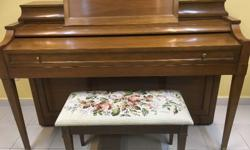 This is a beautiful studio piano with lovely decorative