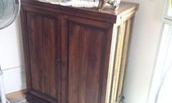 2 year old bar cabinet for sale in good condition.