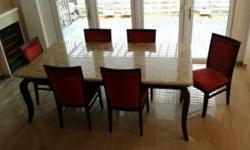 A beautiful marble dining table for sale. *Chairs shown