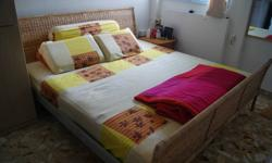 King Size bed with mattress, $40, 2 bedside tables,